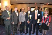 Honoree Carl Biggs, center, president and general manager of Chemical & Engineering Services Inc., with his team at the 2013 Minority Business Leader Awards.