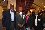 Honoree Stan Wall, second from left, director of real estate at the Washington Metropolitan Area Transit Authority, with his family at the 2013 Minority Business Leader Awards.