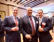 (left) Gene Holzer and Gus Pena (right) of Ascendo Resources with Wilson Lopez (center) of McGladry LLP.