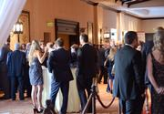 The meeting hall fills up as the networking session progresses.