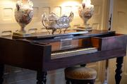 A harpsichord is positioned along one of the walls in the Ladies' Parlor.