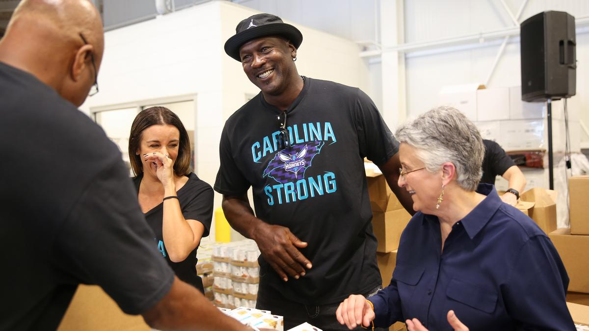 48843a37824 PHOTOS: Michael Jordan, Hornets lend hand for Florence relief as other  Charlotte sports organizations also give support