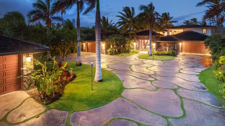"This beachfront estate at 210 N. Kalaheo Ave. in Kailua, Windward Oahu,  sold for $15.65 million. The property has three homes — an eight-bedroom, eight-bath main house, a five bedroom, five-bath ""villa,"" and a three-bedroom, three-bath guest house."