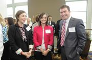 Renaissance Financial's Lexi Schaible, Brook Poskin and Tyler Anderson mingle at the Kansas City Business Journal's 2013 Best Places to Work awards luncheon.