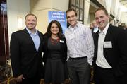 From left, Russell Robinson, Andrea Umbreit of ArtsKC, Josh Peterson of Genesys and Dave Horn of Genesys attend the Kansas City Business Journal's 2013 Best Places to Work awards luncheon.