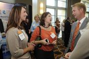 Tracy Marconett (left) and Renee Knopf of NorthPoint Development mingle at the Kansas City Business Journal's Best Places to Work event.