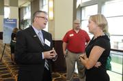 Vince Haworth (left) of U.S. Bank attends at the Kansas City Business Journal's 2013 Best Places to Work awards luncheon.