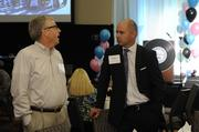 Sean Yokley (right) of CommunityAmerica Credit Union attends the Kansas City Business Journal's 2013 Best Places to Work awards luncheon.