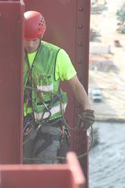 A DOT inspector prepares to rappel under the Mathews bridge to check for damage.