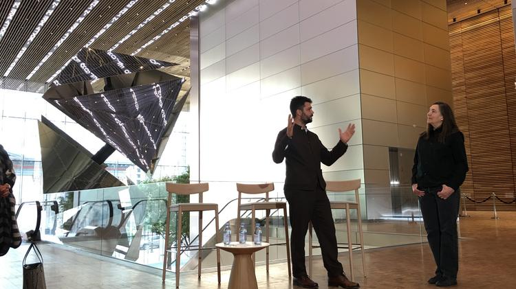 Artist Conrad Shawcross and Jenny Holzer talk about their pieces in the new Comcast Technology Center, with Shawcross's installation behind and Holzer's digital display above.