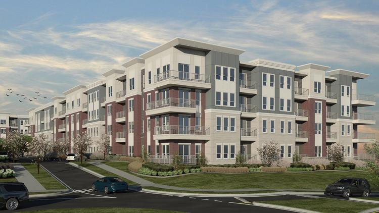 A rendering of one of the four-story residential buildings at District at Deerfield.