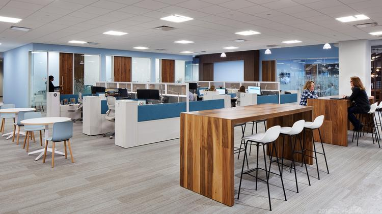 "While the new space is focused more on ""we"" than ""me,"" personal work spaces are stocked with ergonomic chairs, adjustable height desks and the latest in technology."