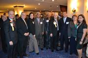Honoree Jorge Haddock, far left, and honoree Hector Torres, center, with the Capital Hotels & Suites team at the 2013 Minority Business Leader Awards.