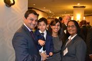Honoree Mehul Sanghani, left, president and founder of Octo Consulting Group, with his family at the 2013 Minority Business Leader Awards.