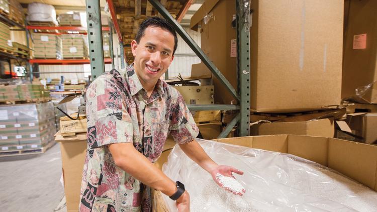 765690e08fa Adrian Hong, president of Island Plastic Bags, Inc. shows the raw plastic  material