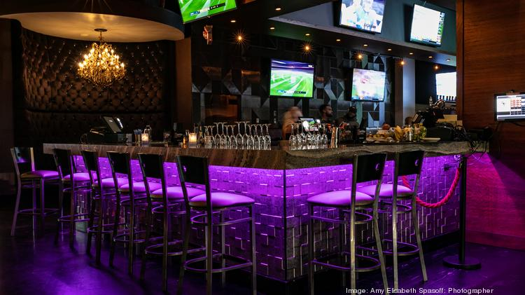 The Bar Area Shows Sporting Events On Large Screen Tvs