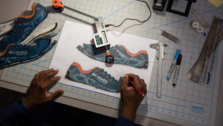 4455b8d7d8e A Columbia Sportswear employee measures the materials used in a shoe to  determine its customs tariff