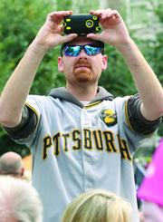 Pirates fan Steve Scheidemantle of Ellwood City documents the Pirates playoff rally.