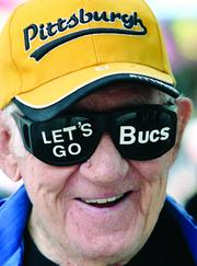 Stanley Zaidel, 88, of the South SIde, wears his Pirates pride on his sunglasses during the Pirates playoff rally in Market Square. Zaidel attended the event with his friend, Jim Kissel, 87, of Brentwood, who said the two of them have been Pirates fans since 1936.