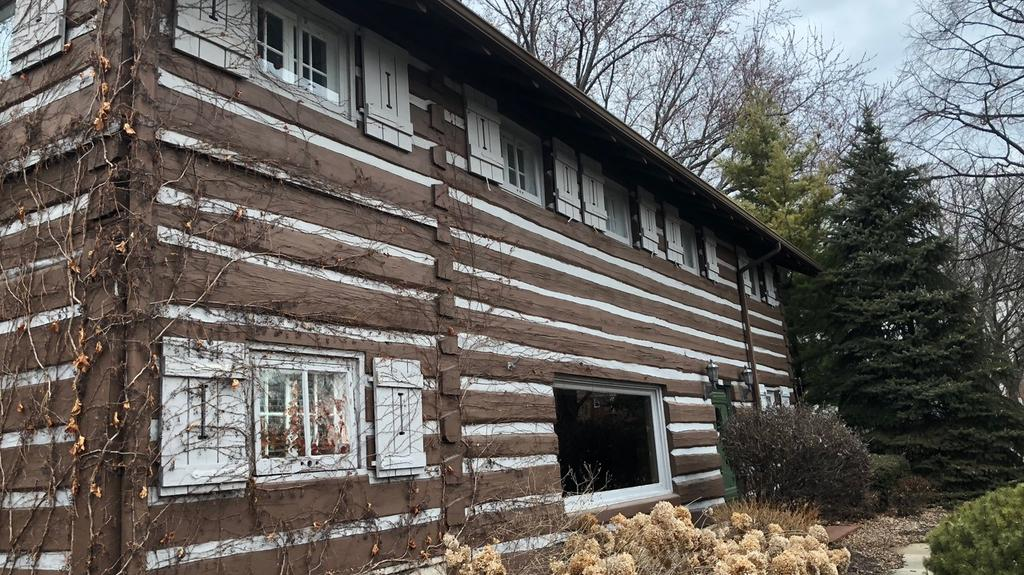 An up close look at the Wauwatosa log cabin's late night move