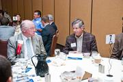 Vic Alexander of KraftCPAs, left, talks with Bill Kenny Jr. of Kenny Pipe & Supply Inc.