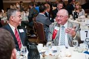 Vic Alexander of KraftCPAs, right, talks with Phil Gibbs of E|Spaces Inc.