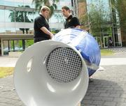 From left: Jeff Leins and Ronald Hofer of the UCF Department of Mechanical & Aerospace Engineering assemble a wind tunnel that will test the launch control system of a rocket they are building with other members of their department for NASA's University Student Launch Initiative.