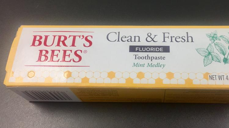 Packaging for the new toothpaste notes that the Burt's Bees trademark and logo are being used by Procter & Gamble under license. The Clorox name doesn't appear on the carton.