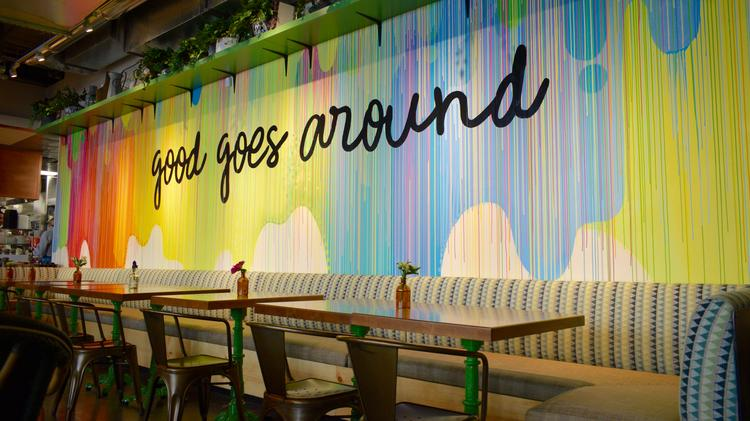 Flower Child in Foggy Bottom features bright murals with wording that  speaks to the restaurant's culture