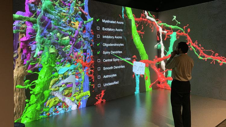 An instructor uses the three dimensional visualization lab at Marquette University.