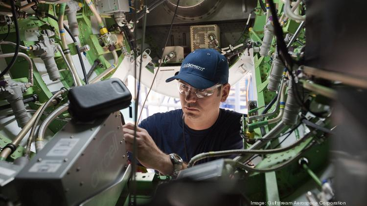 In the following slideshow, take a look inside the Gulfstream facility in Dallas. Here, a Gulfstream employee works on a system aboard the G280.