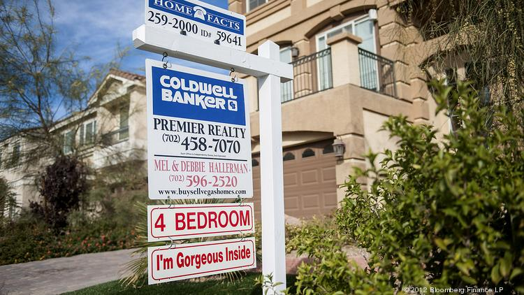 A Coldwell Banker LLC sign is displayed outside of a house for sale. Photographer: Jacob Kepler/Bloomberg