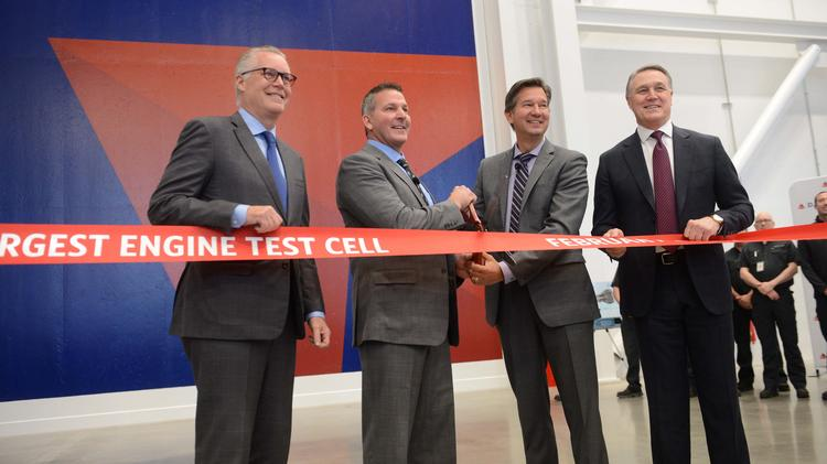 Delta Air Lines CEO Ed Bastian cutting the ribbon with Mike Moore, senior vice president of Delta's maintenance operations; Don Mitacek, senior VP of Delta TechOps; and U.S. Sen. David Perdue for Delta's new 127,000-square-foot state-of-the-art engine repair shop.
