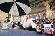 """Travis Ricker, bartender at Atria's Restaurant and Tavern at PNC Park, in Pirates garb serving customers outside and barking out """"beers for sale"""" in a Pirate accent."""