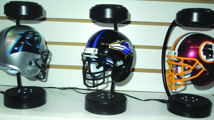 c4fb2098 The popular Hover Helmets, a replica NFL helmet that hovers between two  magnets, helped. Enlarge
