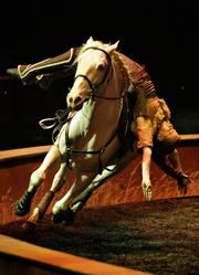 Riders perform stunts on horseback as part of Odysseo, opening at National Harbor Oct. 9.