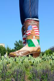 The new Big Tex features giant cowboy boots to go along with his new clothes.