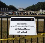 Here's a sign telling the public that the World War II Memorial is closed due to the government shutdown. The Lincoln Memorial can be seen in the distance.