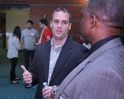 Brandery general manager Mike Bott talks with attendees during the networking portion of Demo Day.