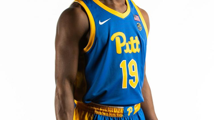c90c7336623 Pitt basketball uniforms, featuring the new color scheme and  Cathedral-inspired typeface for numbers