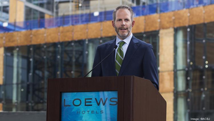 Paul Neidlein speaks during last May's topping-off ceremony for Loews Kansas City Hotel. JE Dunn completed its work in time for an April 2 grand opening, but it was delayed until Kansas City lifted its stay-at-home orders.