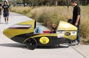 A human-powered transport, designed and built by the UCF chapter of the American Society of Mechanical Engineers (ASME), is taken for a test drive by one of the chapter members. Each year, the club builds a new vehicle to take part in the Human Powered Vehicle Challenge.