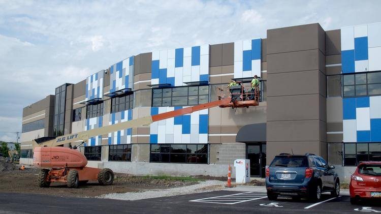 Facade work continues on Tyler Technologies' building project.