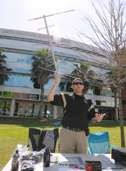 Chris Stevens of the UCF Amateur Radio Club with an antenna used for short wave transmissions. The club builds its own radios.