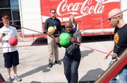 Students use a slingshot to try their skills at a life-size Angry Birds game.