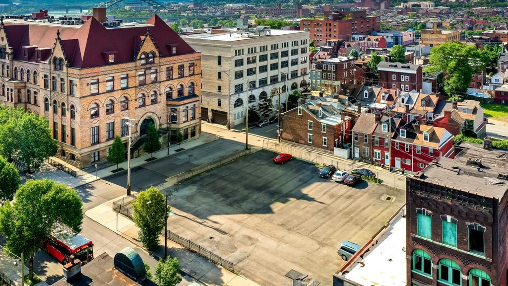 Sal Williams marketing block of Uptown for sale