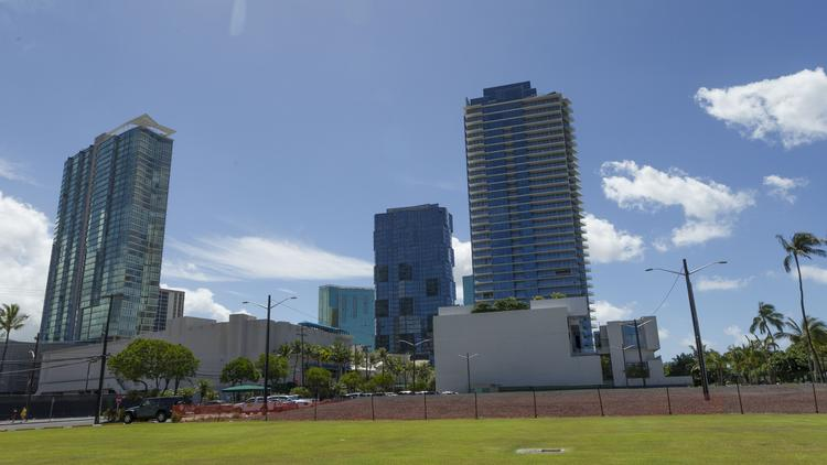 The Howard Hughes Corp.'s towers, from left, Aeo, Anaha and Waiea, are seen from the site of its planned seventh tower, Victoria Place, in Ward Village. New luxury condominium high-rise units appeal to many foreign buyers, especially those from Japan.