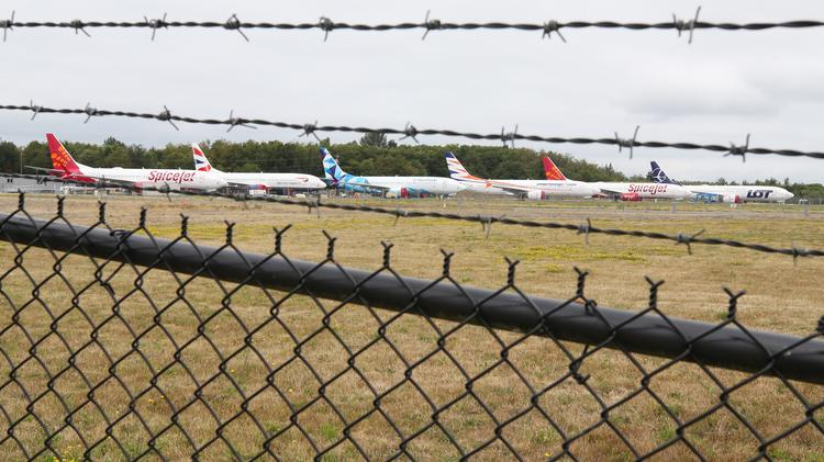 A row of Boeing 737 Max jets are parked next to the runway at Paine Field in Everett on July 23. The jets are manufactured in Boeing's plant in Renton.