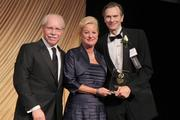 E.W. Scripps Co. CEO Rich Boehne, with PNC Bank President Kay Geiger and honoree Scripps director J. Marvin Quin