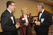 Mark Busher of PNC talks with honoree Cathy Crain of the Cincinnati Opera and Tom Hough of Ernst & Young.